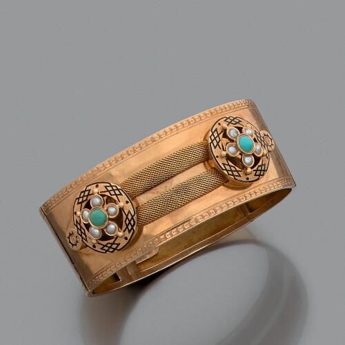 8bb0eba2e1441 Parure en or jaune 18K (750‰) composée d'un large bracelet articulé